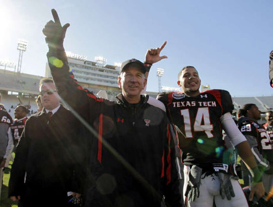 Tommy Tuberville capped off his first season at Texas Tech with a 45-38 victory over Northwestern in the inaugural TicketCity Bowl on Saturday in Dallas. Photo: Sharon Ellman, AP