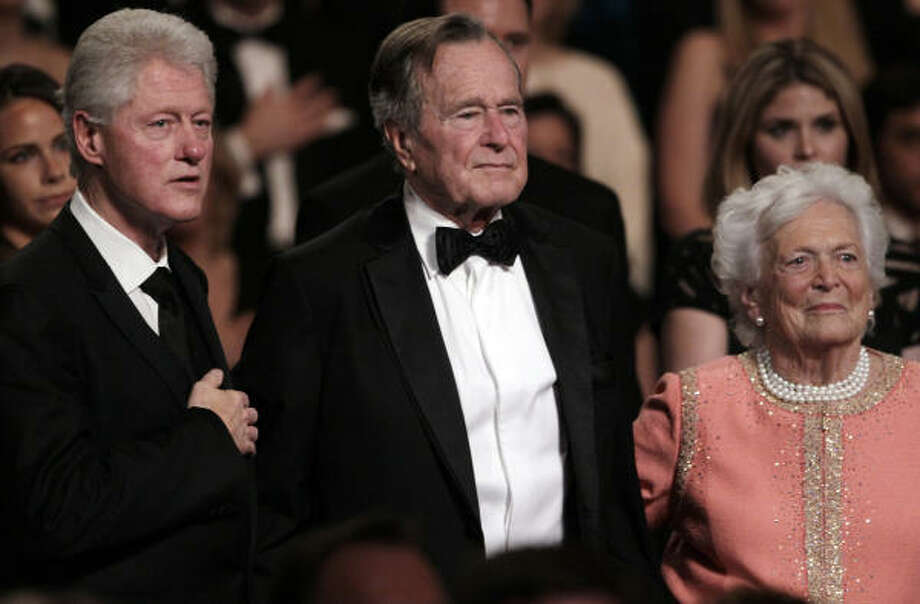 "Former President Bill Clinton, former President George H.W. Bush and wife Barbara Bush stand for the National Anthem at the Kennedy Center on Monday in Washington, before the ""All Together Now - A Celebration of Service"" performance. Photo: Carolyn Kaster, AP"