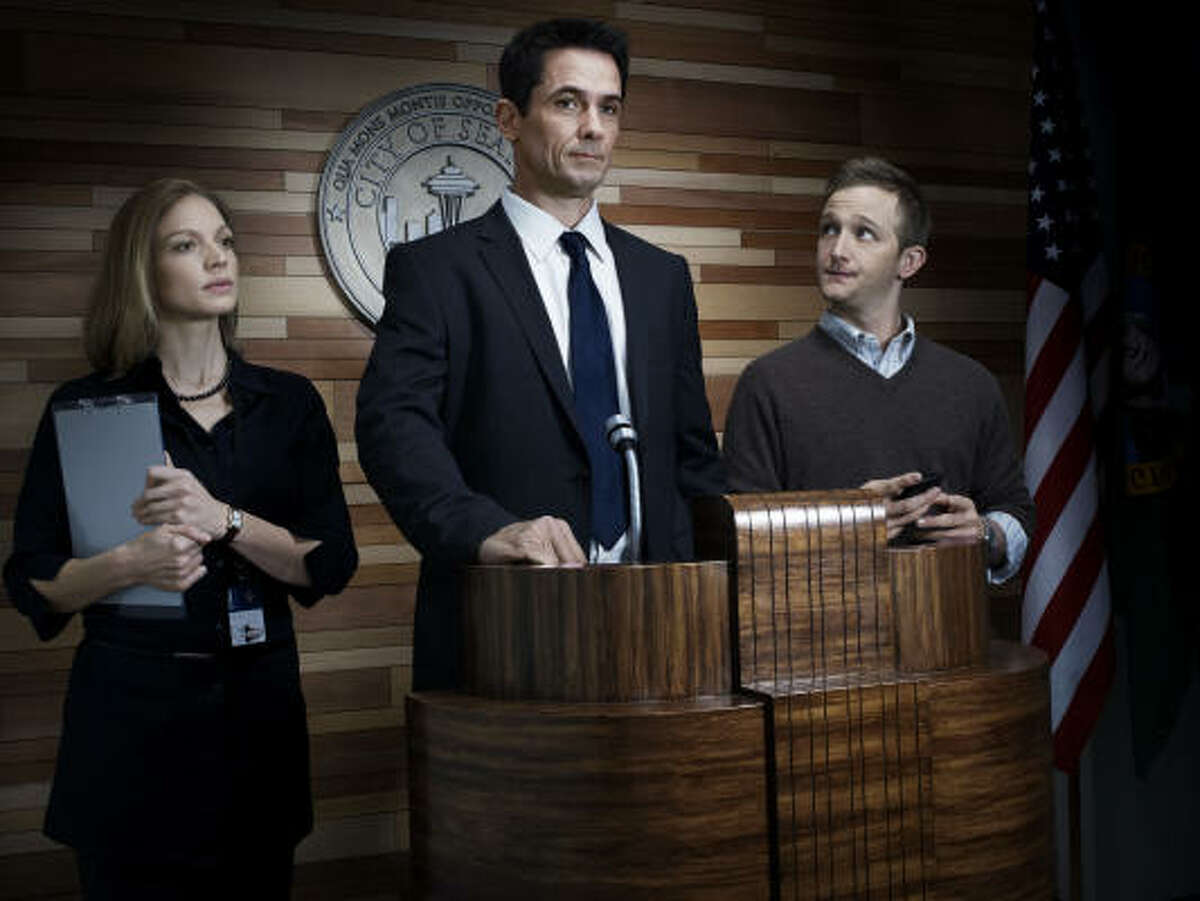 Kristin Lehman, from left, Billy Campbell and Kinkaid graduate Eric Ladin in a scene from AMC's The Killing.