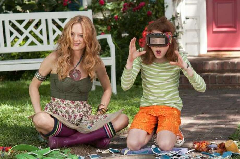 Aunt Opal (Heather Graham, left) devises a competition between Judy (Jordana Beatty) and her friends in an attempt to make summer vacation fun. Photo: Relativity Media, Suzanne Tenner