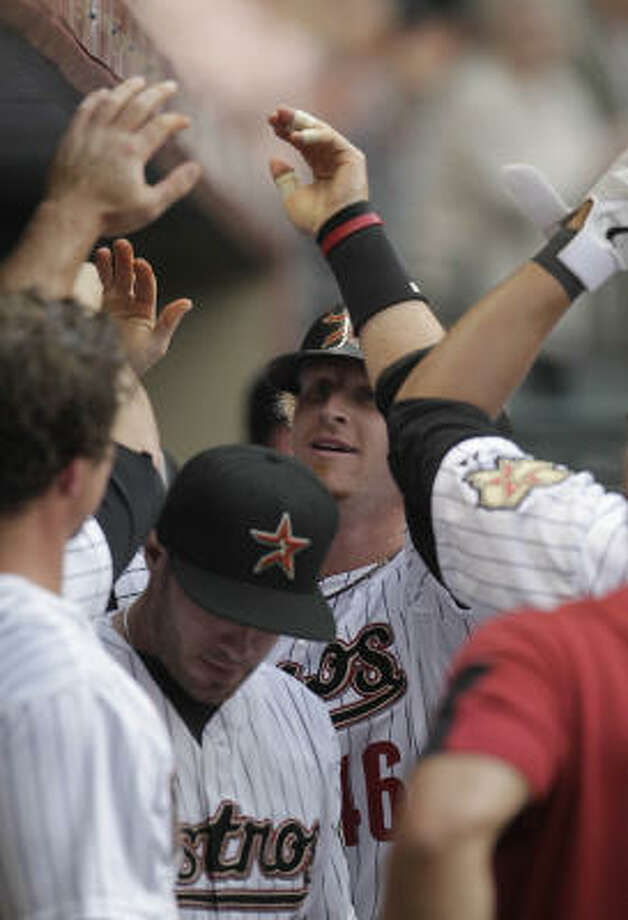 Astros catcher J.R. Towles celebrates his solo home run during the third inning of the Astros' home-opening loss on Friday night. Photo: Karen Warren, Chronicle
