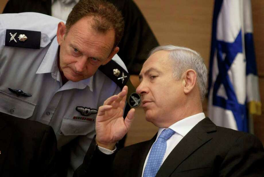 Israeli Prime Minister Benjamin Netanyahu, right, listens to his military advisor Maj. Gen. Yohanan Locker, as he attends a meeting of the Foreign Affairs and Defense Committee, in the Knesset, Israel's parliament in Jerusalem, Monday, Aug. 1, 2011. (AP Photo/Sebastian Scheiner) Photo: Sebastian Scheiner / AP