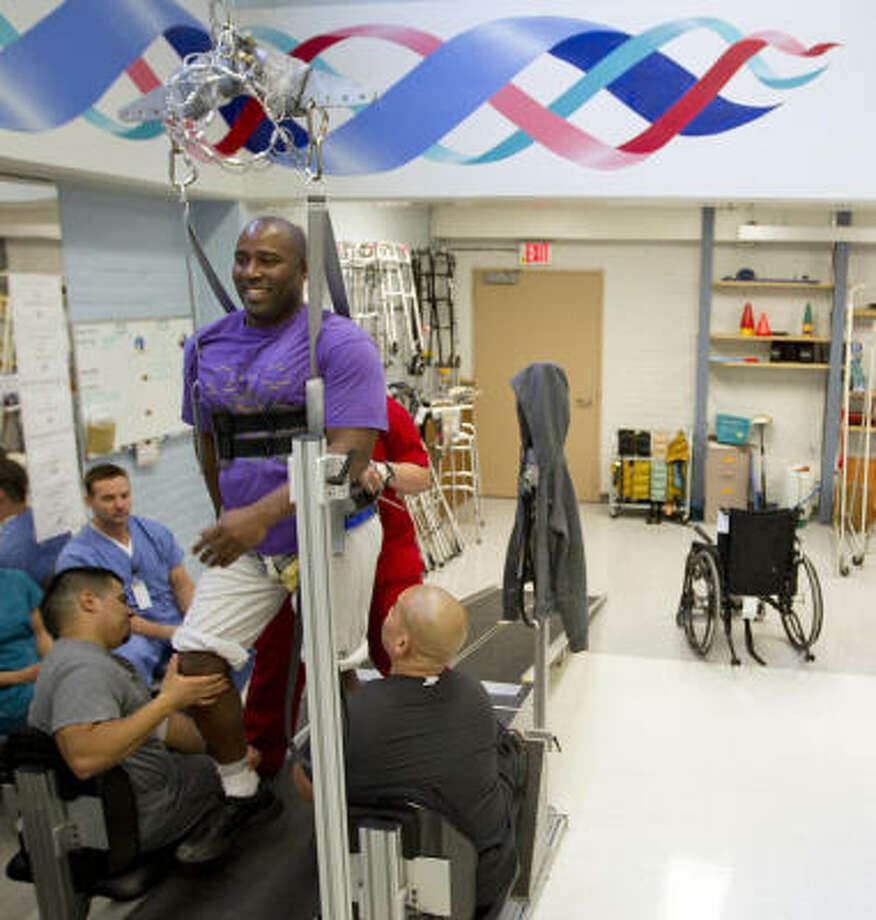 Patient Earl Franklin works with rehabilitation staff on a Therastride machine Thursday at The Institute for Rehabilitation and Research Memorial Hermann in Houston, where Rep. Gabrielle Giffords is to begin the next phase of her recovery. Photo: Smiley N. Pool, Chronicle