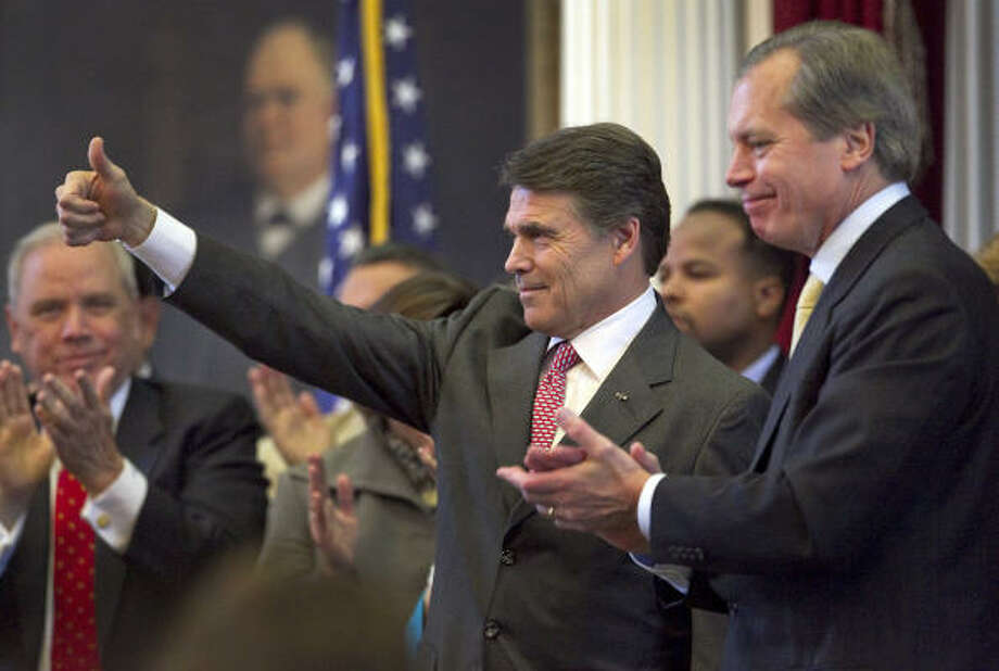 "Gov. Rick Perry stands with Lt. Gov. David Dewhurst after he addressed a joint house of legislators Tuesday. Perry declared there are ""no sacred cows"" in the strapped Texas budget, but he found a few hallowed programs that came close: the ones he uses to reward companies that expand or relocate to Texas. Photo: Ralph Barrera, AP Photo/Austin American-Statesman"
