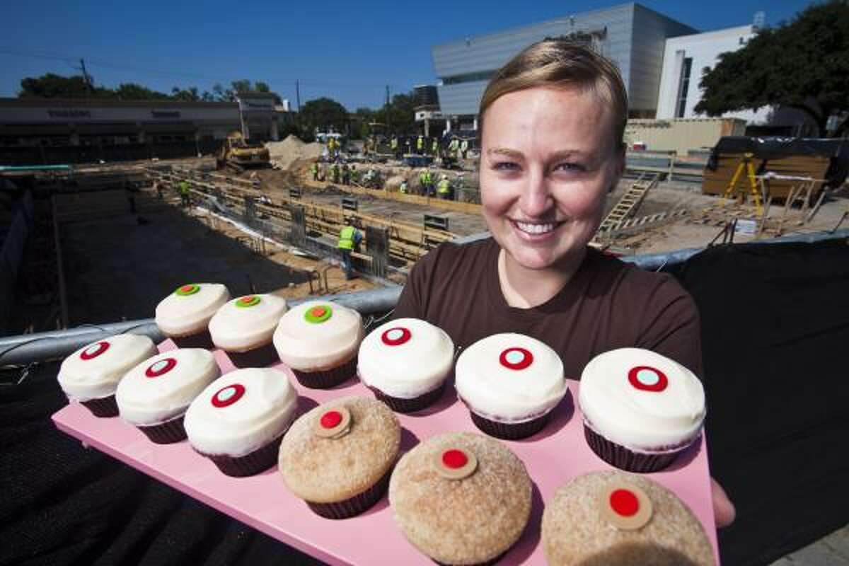 Sprinkles Cupcakes manager Julie Linhart has lots of goodies to sell - when customers find the shop. Sprinkles President Charles Nelson says he's glad to be in a prime Highland Village spot, but he regularly gets calls from people asking if the shop is open as work goes on around the shop.