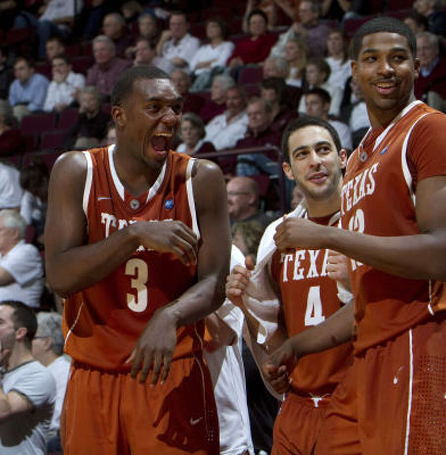 Texas' Jordan Hamilton (3), Dogus Balbay (4) and Tristan Thompson, right, celebrate after a basket during the second half on Monday night. Photo: Jon Eilts, AP