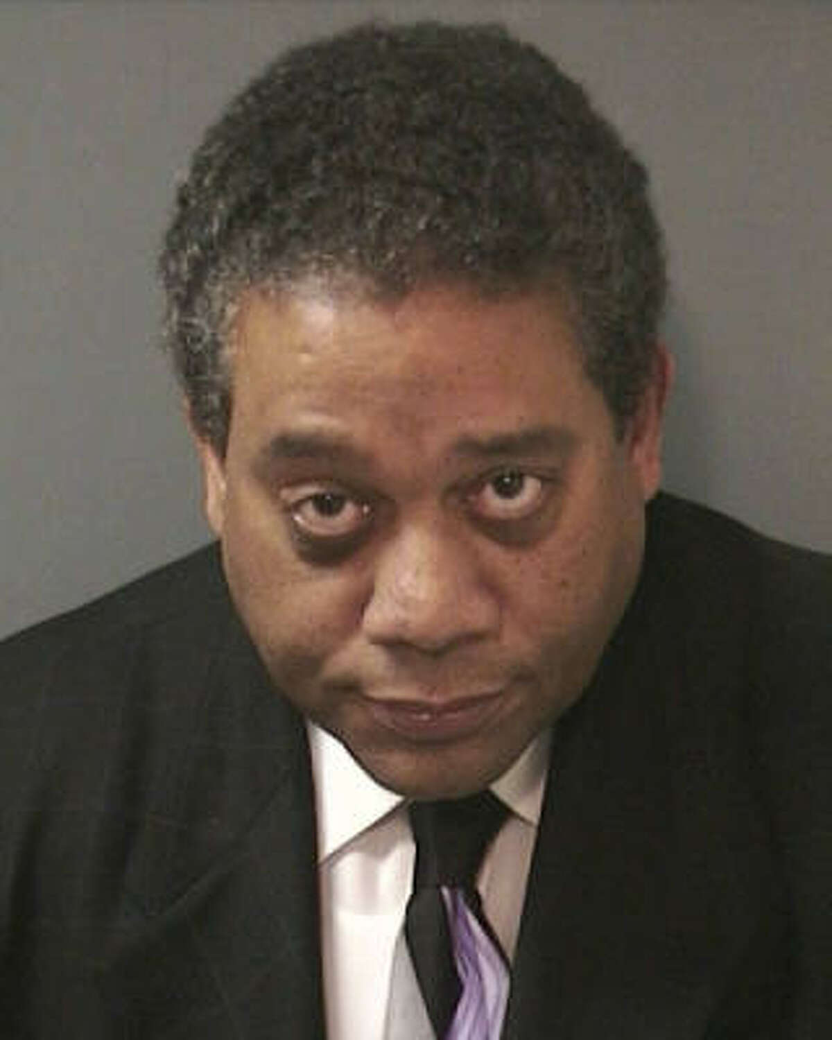 Former financial services director Edwin Harrison declined comment about allegations.