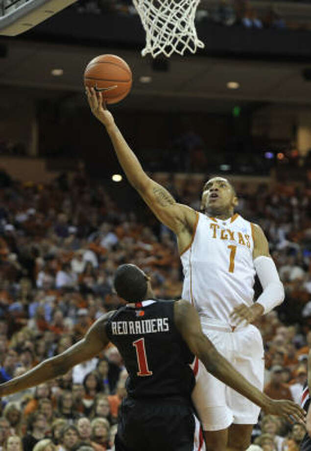 Texas forward Gary Johnson, right, lays the ball in the basket for two of his 16 points. Photo: Michael Thomas, AP