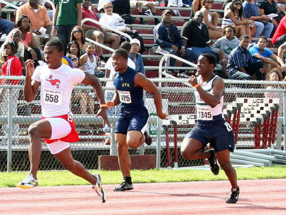 North Shore's Jaylon Hicks, left, won the 100 meters in 10.71 seconds. Photo: Gerald James, For The Chronicle