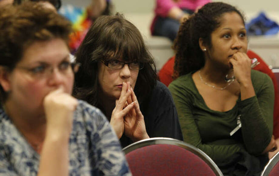 Amber Pappas, left, who wants her son to attend a magnet program; Susan Martin, center, a Scroggins Elementary art teacher; and Maritza Quinones, a Scroggins Elementary math teacher, right, were among some 300 at Thursday's meeting. Photo: Melissa Phillip, Chronicle