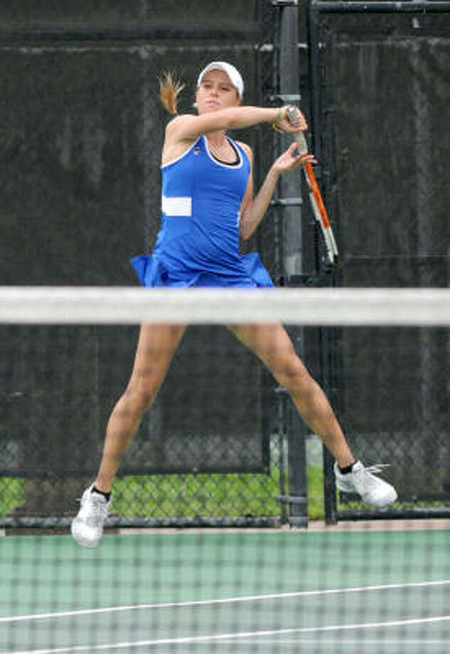 Annat Rabinovich brings home more gold for Katy Taylor, teaming with Crystal Leung to win the 5A doubles. Photo: JERRY BAKER, For The Chronicle
