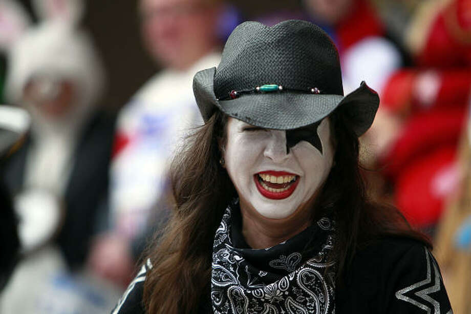 Marzi Petris shows off her KISS makeup Saturday during the costume contest at the ConocoPhillips Rodeo Run. This year's concert performers include the legendary rock band. Photo: Johnny Hanson, Chronicle