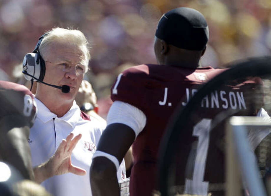 Texas A&M coach Mike Sherman stresses the big picture when discussing recruiting with his coaches. Photo: Julio Cortez, Chronicle