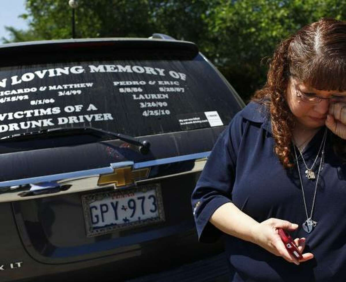 Christi Zamarripa, of San Antonio, lost both of her sons to drunken drivers. A sign on her vehicle aims to raise awareness of the problem. She says nothing will change until those who provide the alcohol face tougher penalties.