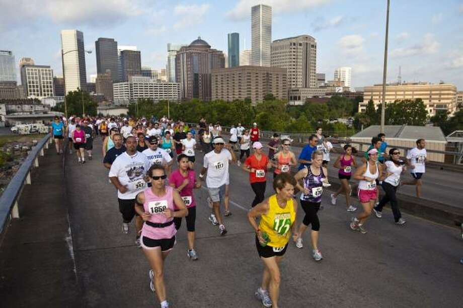 The Astros Race for the Pennant 5K, which drew close to 2,000 participants on May 30, is further proof of Houston's growing reputation as one of the nation's top running cities. Photo: Eric Kayne, For The Chronicle