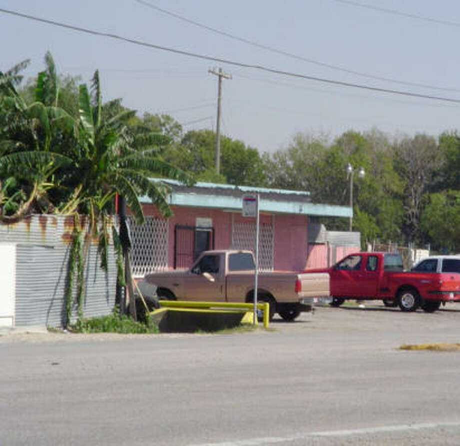 This the front of the bar that faces Clinton Drive. Investigators say that for more than 10 years, sex traffickers have used the site to conduct business. Previous efforts to target those behind the establishment have been difficult, mostly because of legal tactics used by the owners. Photo: Handout Photo