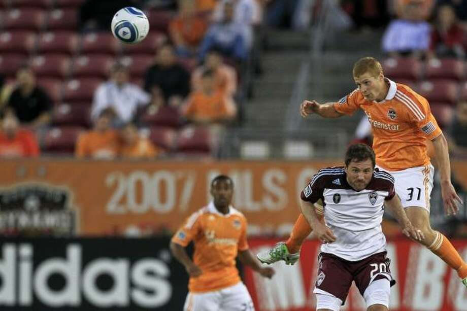 Andre Hainault, right, has been the most versatile piece to the Dynamo's defense this year. Photo: Michael Paulsen, Chronicle