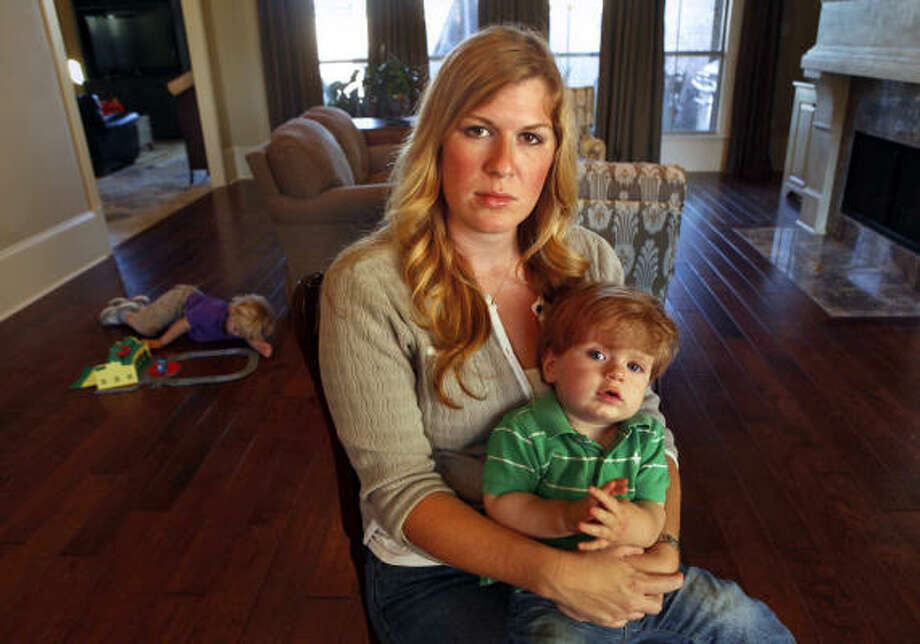 "Michelle Jones, of Baton Rogue, La., lost her husband, Gordon, in the Gulf disaster. Her father-in-law, Keith Jones, says 1-year-old Max ""looks just like Gordon at that age."" Photo: Carolyn Cole, Los Angeles Times"