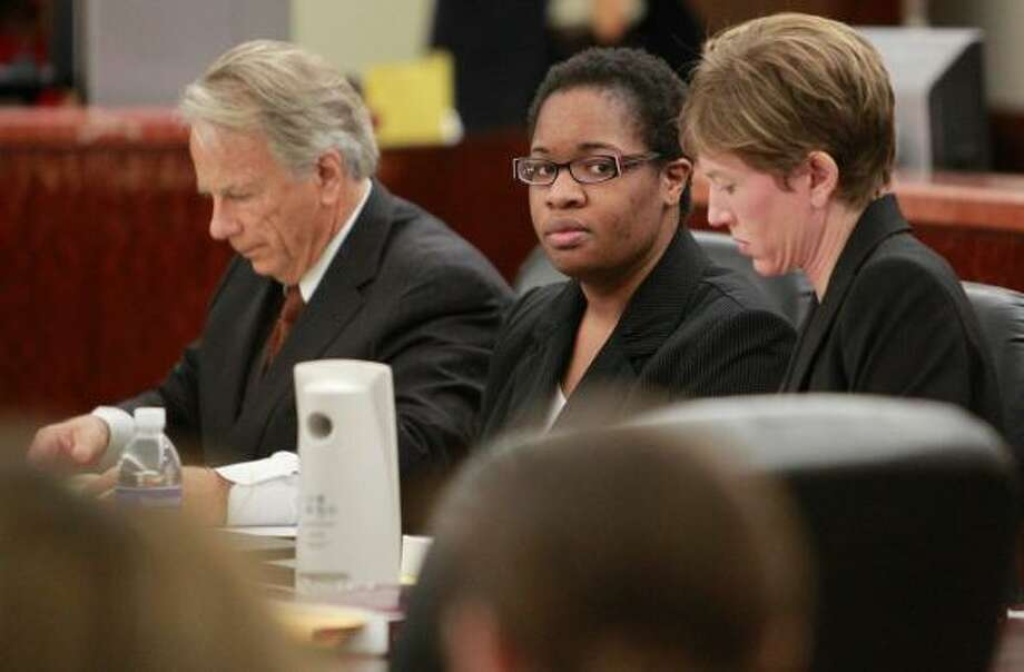 Jessica Tata is flanked by defense attorneys during a bail reduction hearing Friday in the Harris County Criminal Courthouse. Photo: Mayra Beltran, Chronicle
