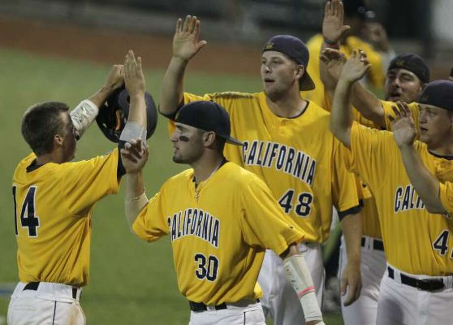 California's (14) Tony Renda, left, celebrates during Tuesday night's victory. Photo: Melissa Phillip, Chronicle
