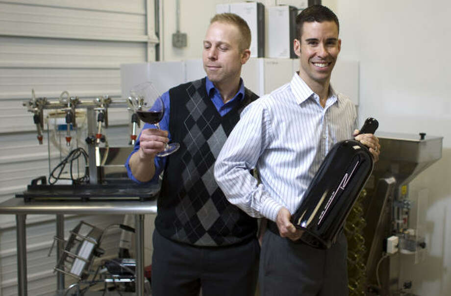 Nice Wines partners Ian Eastveld, left, and Ryan Levy have a wine mixing lab in Houston and recently won gold medals for their estate-bottled selections at the Houston Livestock Show and Rodeo wine competition. Photo: Nick De La Torre :, Chronicle
