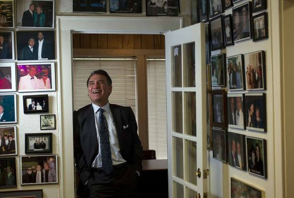 """Surrounded by pictures of himself with various celebrities, Houston's David Acosta says he's """"CPA to the stars."""""""
