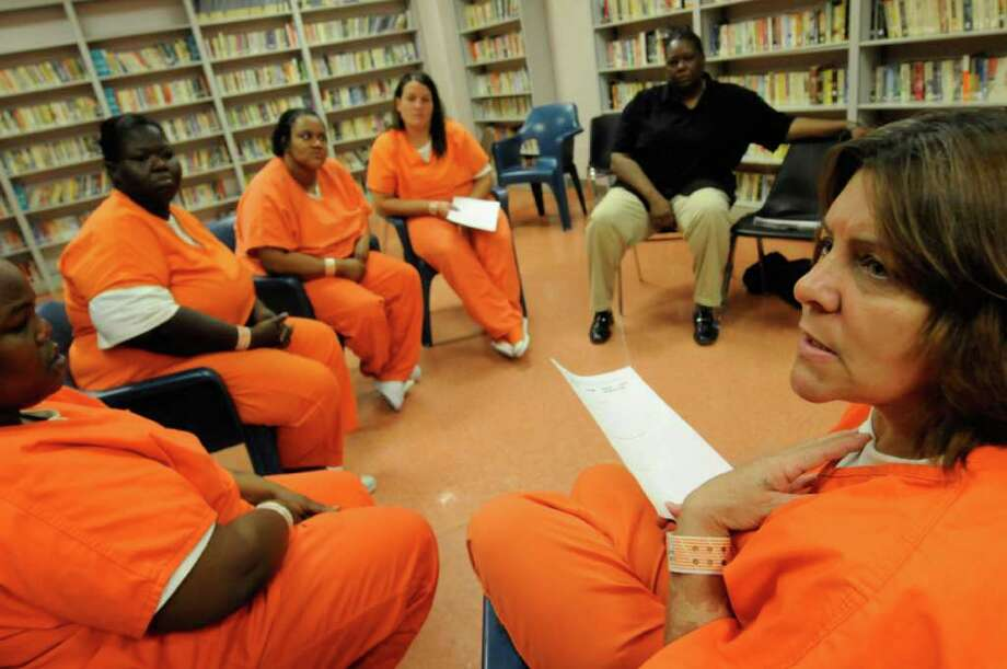 Inmate Jaqueline Andrews, right, speaks during a Sistas Healing Old Wounds meeting run by Veronica Minter at the Schenectady County Jail in Schenectady, NY Friday July 22,2011.( Michael P. Farrell/Times Union) Photo: Michael P. Farrell
