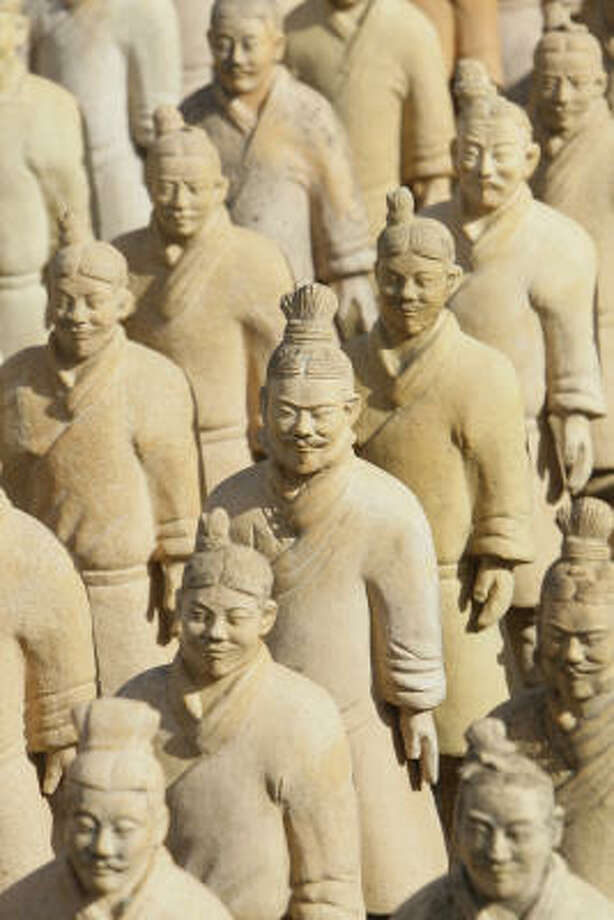 Items from Forbidden Gardens in Katy, including its terra-cotta army, are for sale. Photo: Melissa Phillip, Houston Chronicle