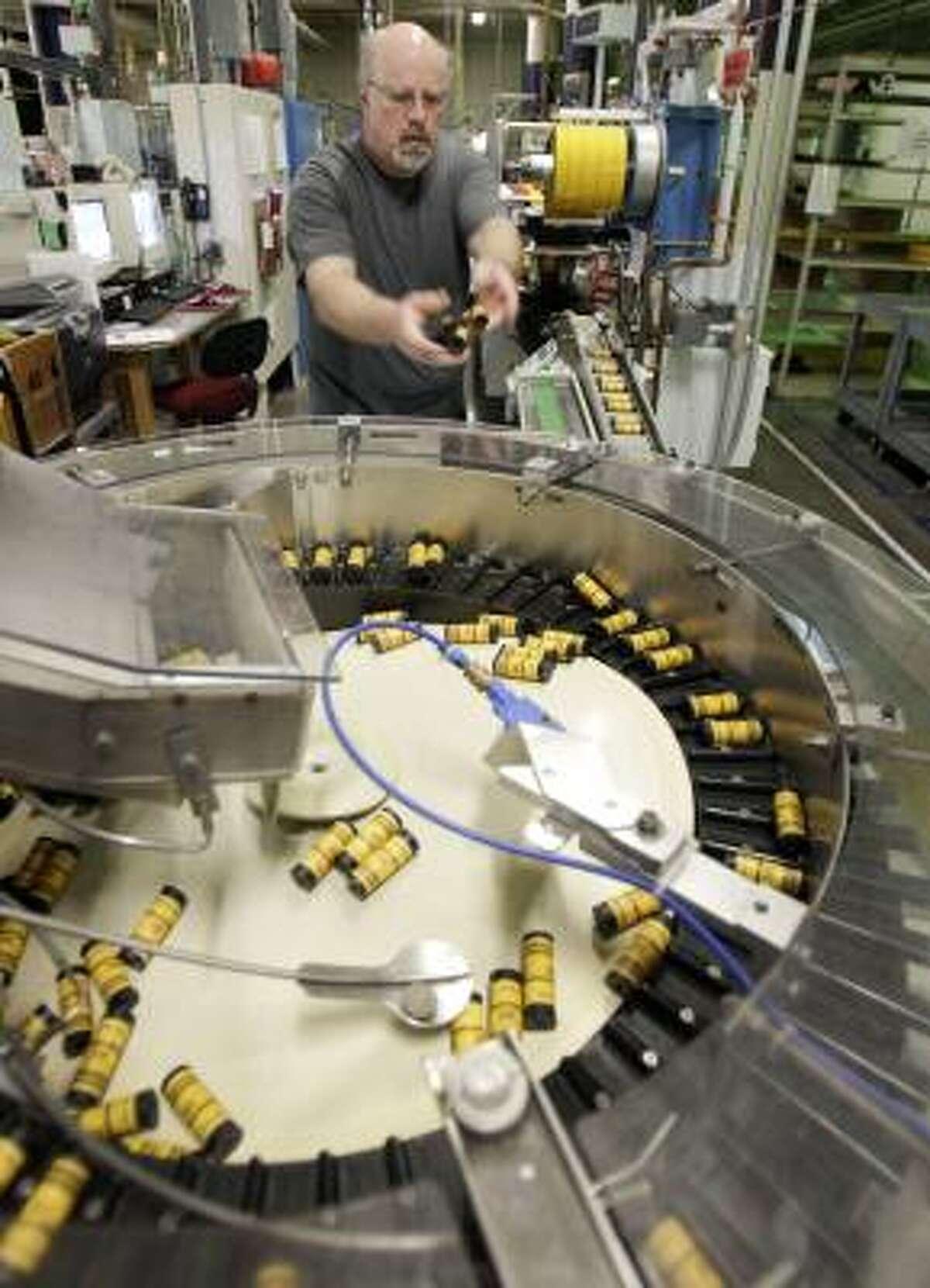 Kodak employee Dan Vandelinder loads medium-format film for packaging last week in Rochester, N.Y.
