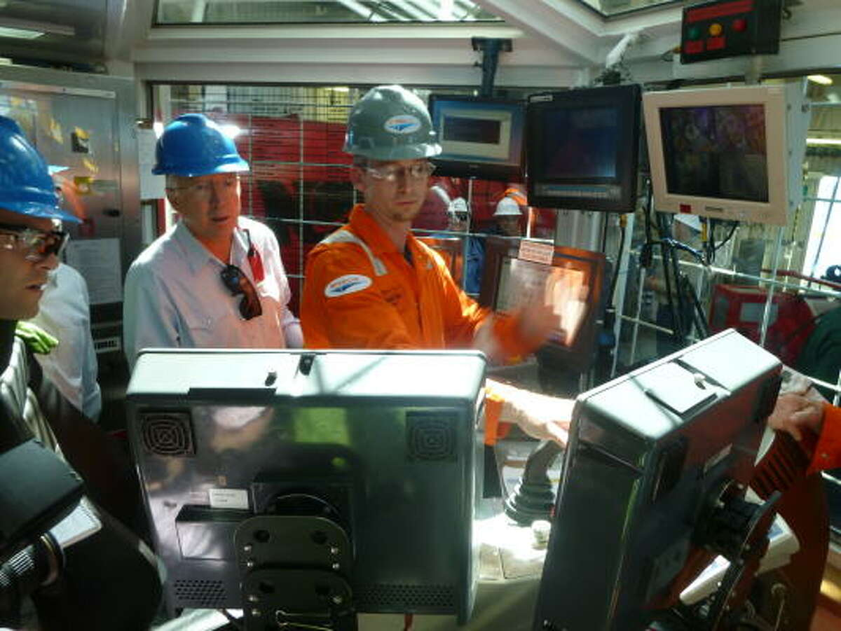 Driller Shad Allen explains to Interior Secretary Ken Salazar the data he can see from his station inside the drill shack at the heart of the Ensco 8501 rig.