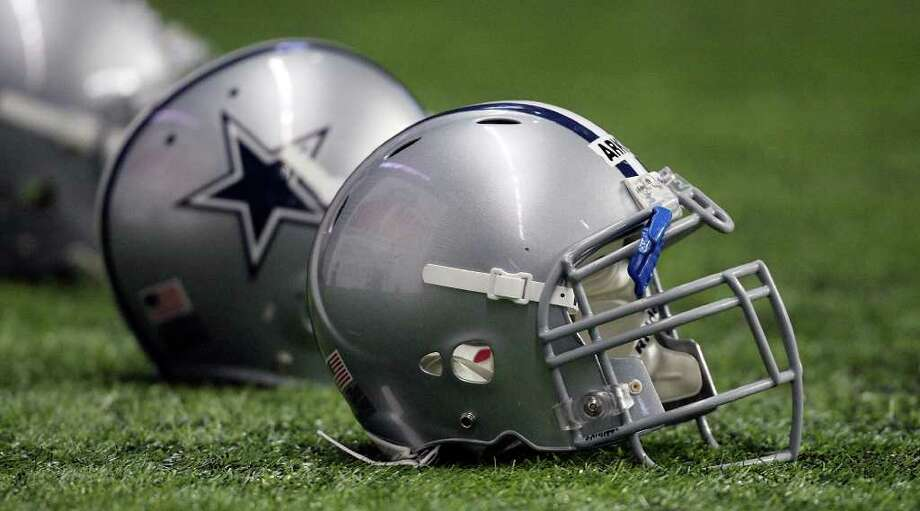 Cowboys rookies are being issued helmets without the star logo until they earn it in the eyes of coach Jason Garrett. Photo: Edward A. Ornelas/eaornelas@express-news.net / © SAN ANTONIO EXPRESS-NEWS (NFS)