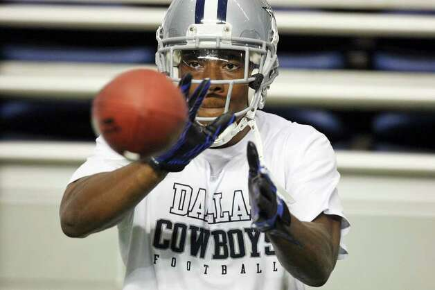Wide receiver Teddy Williams catches a ball during the afternoon session of Dallas Cowboys training camp Monday, Aug. 1, 2011 at the Alamodome. Photo: Edward A. Ornelas/eaornelas@express-news.net / © SAN ANTONIO EXPRESS-NEWS (NFS)