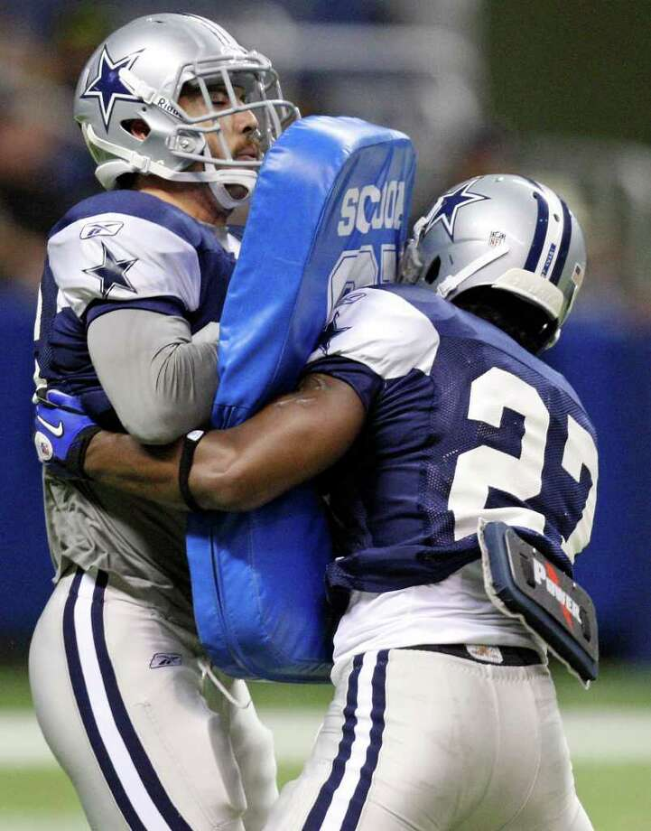 Safety Andrew Sendejo (left), taking part in a drill with Akwasi Owusu-Ansah, has found success playing with a constant chip on his shoulder. Photo: Edward A. Ornelas/eaornelas@express-news.net / © SAN ANTONIO EXPRESS-NEWS (NFS)