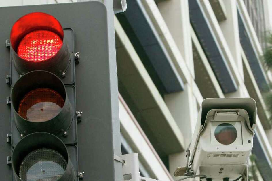 At least three dozen Texas cities use red-light cameras. This one, in Los Angeles, was turned off Sunday, along with the other 31 cameras in the program, because of difficulty collecting fines. Houston has collected $44 million since 2007.
