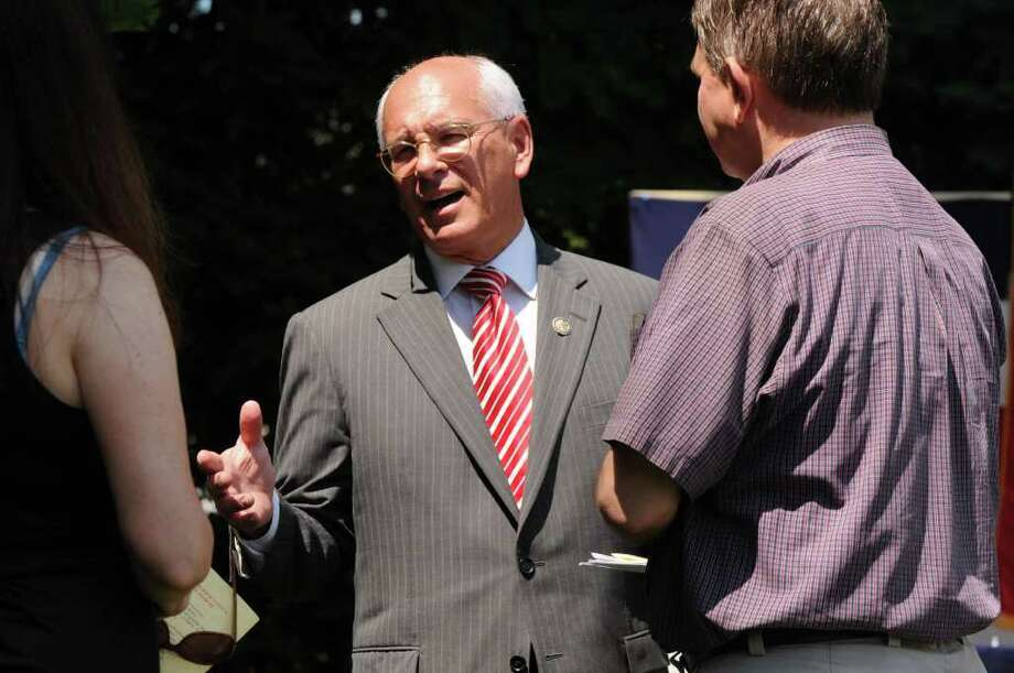 U.S. Rep. Paul Tonko, center, chats with Jill, left, and Steve Baboulis, right of Bethlehem following a reading of the Declaration of Independence at Bethlehem Town Library in Delmar N.Y., Monday July, 4 2011. (Will Waldron /Times Union) Photo: Will Waldron / 00013800A