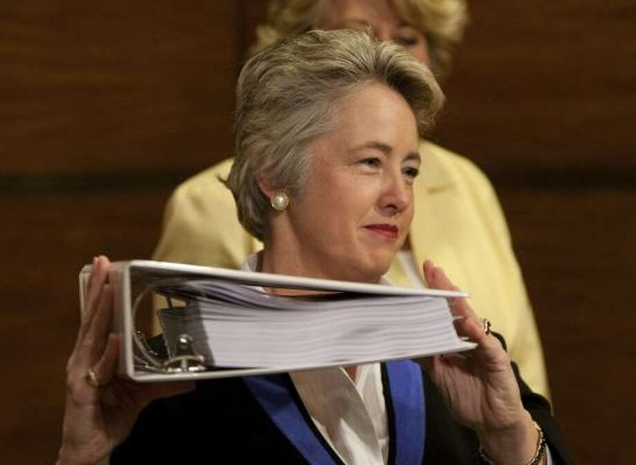 Mayor Annise Parker holds up the ring-bound city budget during Thursday's news conference at City Hall. Her $1.8 billion proposal now goes to the City Council for consideration. Photo: Nick De La Torre, Chronicle