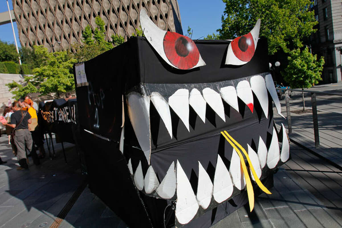 """Demonstrators call attention to the """"Tunnel Monster"""" during Monday's rally to reject Referendum 1 -- the Aug. 16 vote on part of an agreement between the Seattle City Council and state on the deep-bore tunnel replacement for the Alaskan Way Viaduct."""