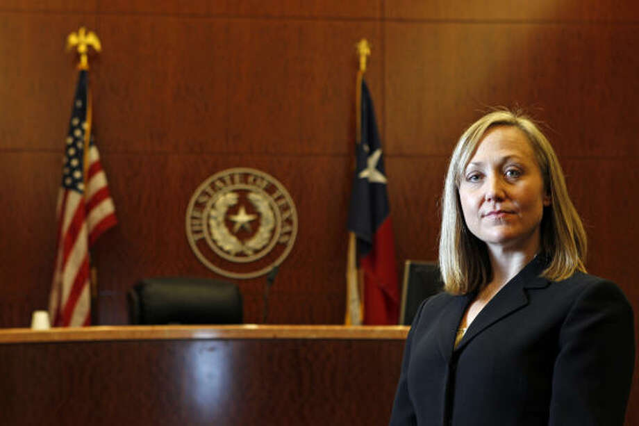 """Alicia O'Neill says she went to work in the Harris County District Attorney's Office because she wanted to help people who have been hurt. """"They deserve to have somebody stand up for them,"""" she says. Photo: Melissa Phillip, Houston Chronicle"""
