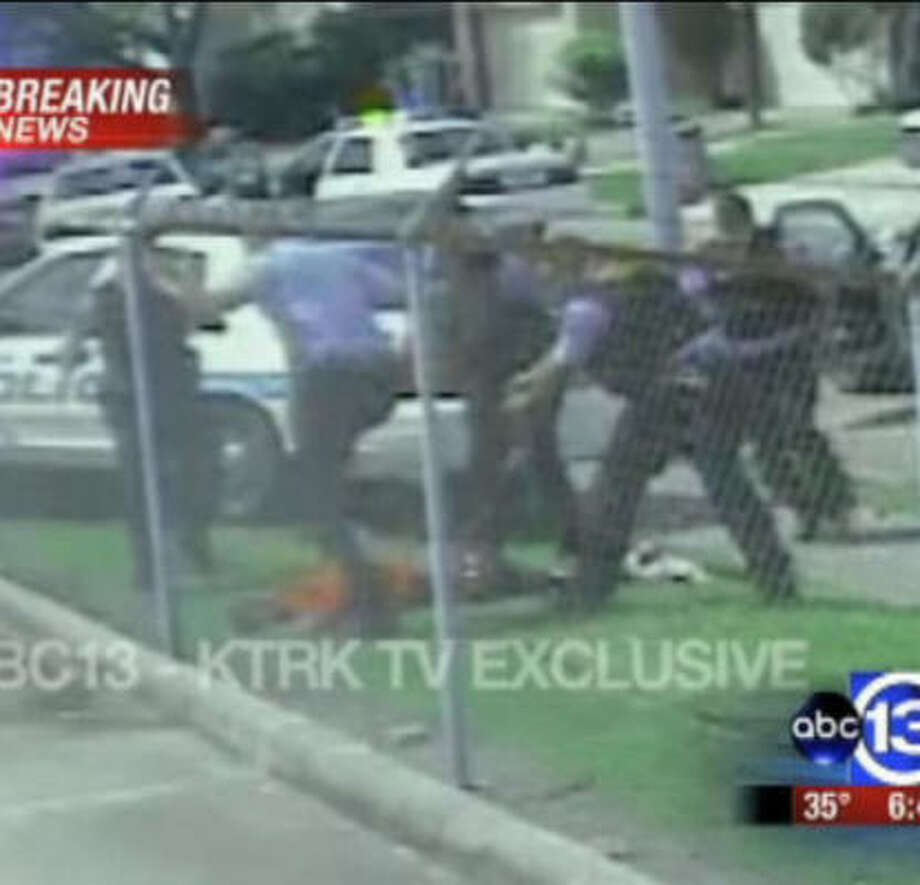 A frame from a video obtained by KTRK allegedly shows Chad Holley, 15, being beaten by HPD officers. Seven officers were fired over the beating. Photo: KTRK-Channel 13