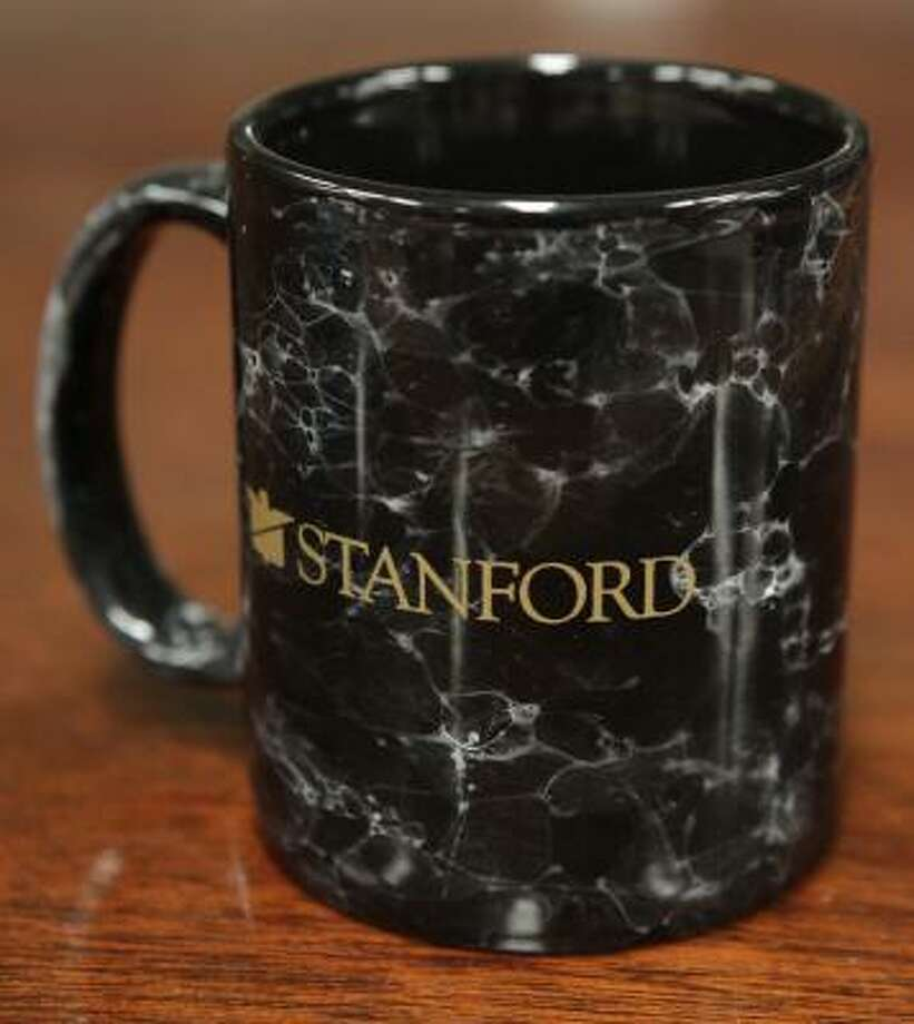 Stanford coffee mugs are one of many items that once belonged to disgraced financier R. Allen Stanford that will be auctioned at Seth Worstell Auction Company, 4200 Blaffer St. Photo: Melissa Phillip, Chronicle