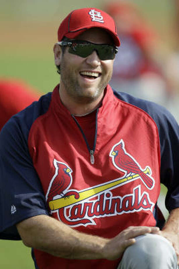 Lance Berkman still wears a red jersey, but it looks quite different than seasons past. Photo: Jeff Roberson, AP