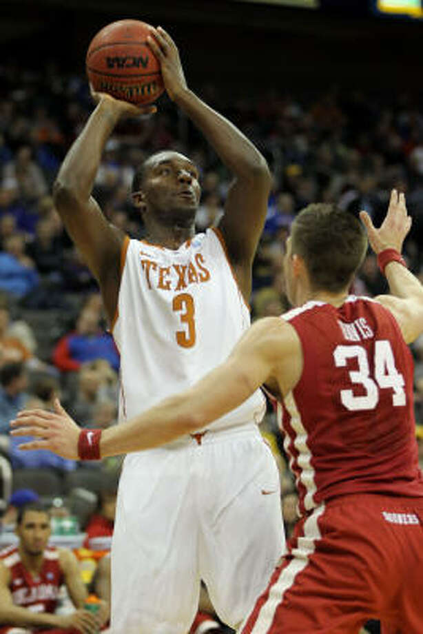 Texas guard Jordan Hamilton looks to score two of his game-high 22 points in Thursday's victory. Photo: Jamie Squire, Getty Images