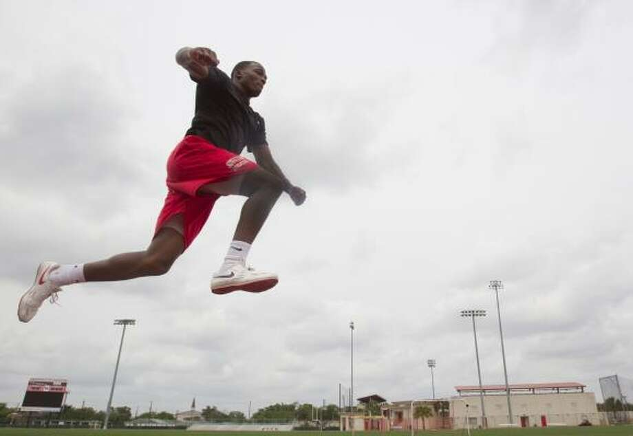 Before making his way to the University of Houston, triple jumper Chris Carter set a national AAU record for his age group while a senior at Hearne High School. He will defend his C-USA outdoor title in the event this weekend at Rice. Photo: Melissa Phillip, Chronicle