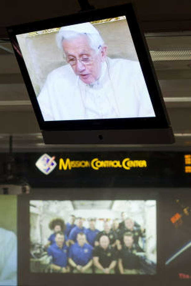 Video feeds in Mission Control at Johnson Space Center show Pope Benedict XVI at the Vatican talking with astronauts on the International Space Station. Photo: Nathan Lindstrom, Chronicle