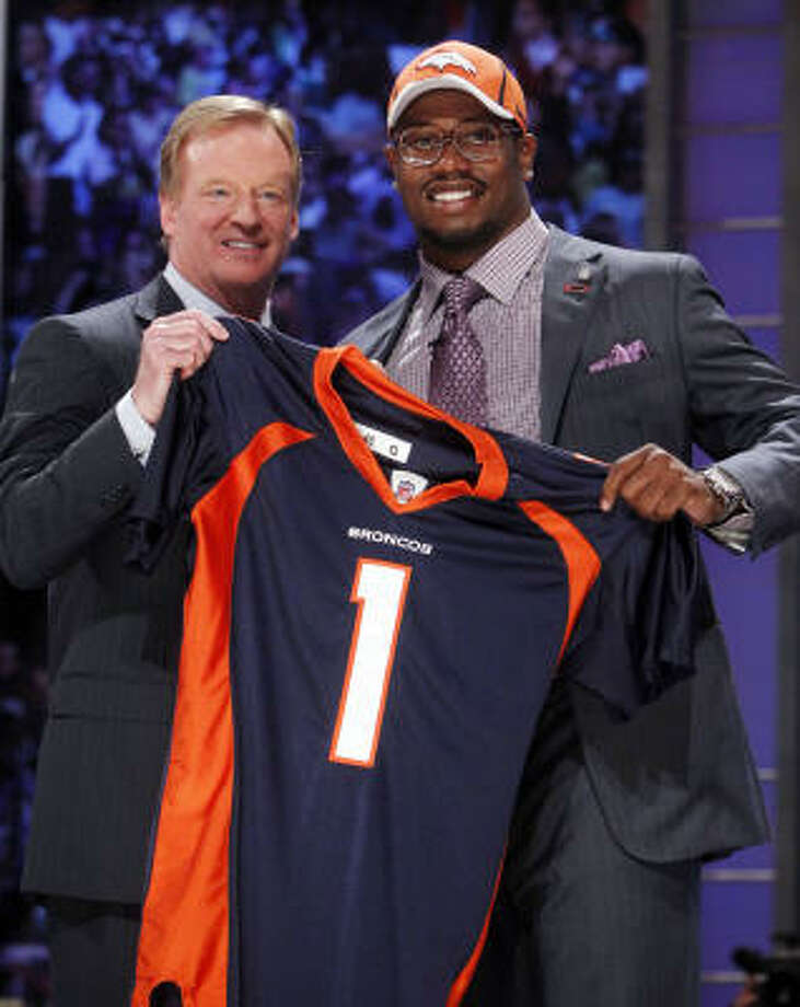 Texas A&M linebacker Von Miller holds up a Broncos jersey with commissioner Roger Goodell. Photo: Jason DeCrow, AP