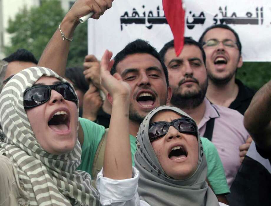 Members of a pro-Islamic human rights group and Syrians living in Turkey shout slogans against the Syrian regime and leader Bashar Assad during a protest outside the Syrian embassy in Ankara, Turkey, Monday, Aug. 1, 2011.(AP Photo) / AP