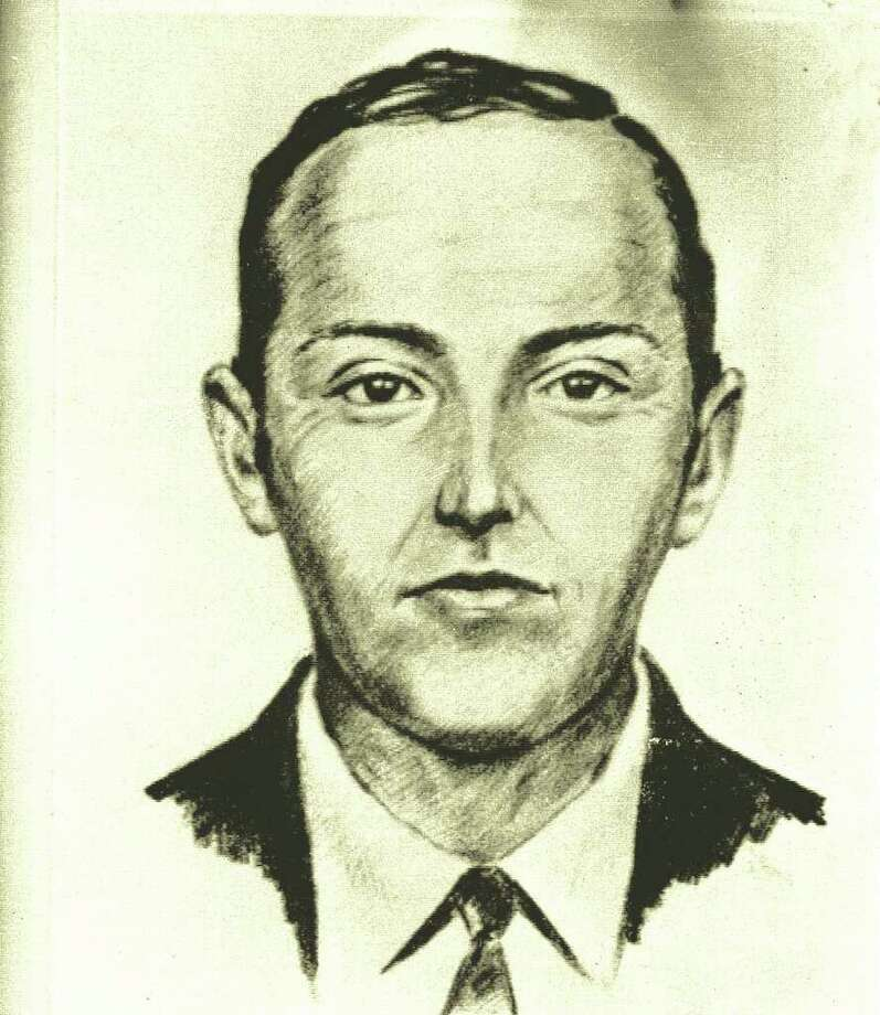 FILE--A 1971 artist's sketch released by the FBI shows the skyjacker known as 'Dan Cooper' and 'D.B. Cooper',  was made from the recollections of passengers and crew of a Northwest Orient Airlines jet he hijacked between Portland and Seattle, Nov. 24, 1971, Thanksgiving eve.   FBI spokeswoman Ayn Sandalo Dietrich tells The Seattle Times that a law enforcement member directed investigators to a person who might have helpful information on Cooper. (AP Photo/FBI/file) Photo: Anonymous / AP1971