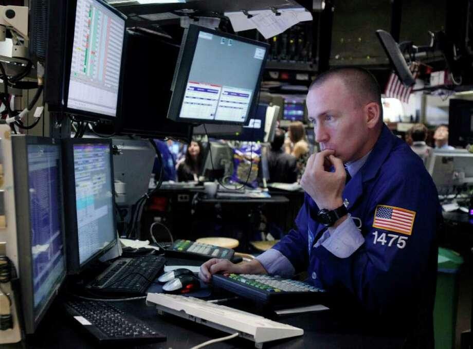 Specialist James Ahrens works on the floor of the New York Stock Exchange Monday, Aug. 1, 2011. (AP Photo/Richard Drew) Photo: Richard Drew