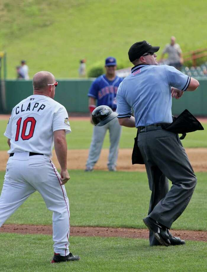 Tri-City ValleyCats coach Stubby Clabb is ejected from the ValleyCats vs. Auburn Doubledays game at Bruno Stadium, Troy on Monday, August 1, 2011 by umpire Jeff Andrews. (Erin Colligan / Special To The Times Union)