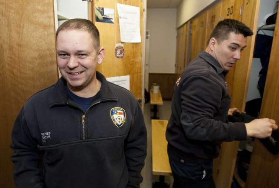 EMT Josh Rieves talks about his delivery drama as the next shift at HFD Station 46 scrambles to answer a call Friday. Photo: Nick De La Torre, Chronicle
